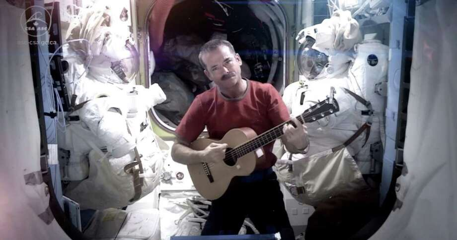 This image provided by NASA shows astronaut Chris Hadfield recording the first music video from space Sunday May 12, 2013. The song was his cover version of David Bowie's Space Oddity. Hadfield and astronaut Thomas Marshburn are scheduled to return to earth Monday May 13, 2013. (AP Photo/NASA, Chris Hadfield) Photo: Cmdr. Chris Hadfield