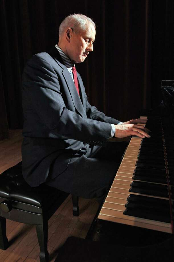 Times Union Staff photograph by Philip Kamrass -- Findlay Cockrell plays piano in the UAlbany Performing Arts center recital hall at the uptown campus in Albany, NY Thursday March 2, 2006. FOR JODY DALTON STORY. Photo: PHILIP KAMRASS / ALBANY TIMES UNION