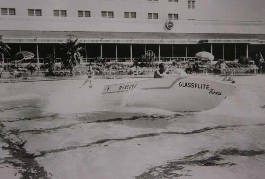A photograph from the pool in the Shamrock Hilton Hotel in Houston demonstrates the size of the pool in that a ski boat with a skiier could put on a demonstration. It is among the items displayed in the Hilton College of Hotel and Restaurant Management's Library and Hospitality Industry Archives. Nick and Vicki Massad have made a grant to the Conrad H. Hilton College of Hotel and Restaruant Management's Library and Hospitality Industry Archives.  (Thursday, Sept. 27, 2007, in Houston. ( COPY SHOT by Steve Campbell / Chronicle)