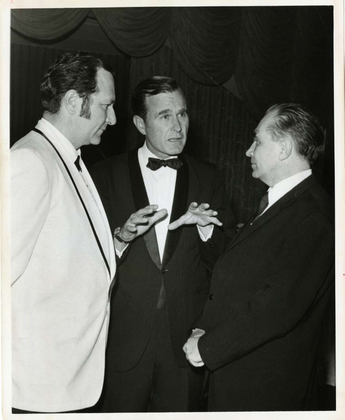(From left) Professor Nicolai Blokhin of Moscow, U.S. Rep. George Bush and Dr. Emil Freireich of Houston spoke at dinner given by Houston chapter of the Leukemia Society of America in 1970. Bela Ugrin / Houston Post