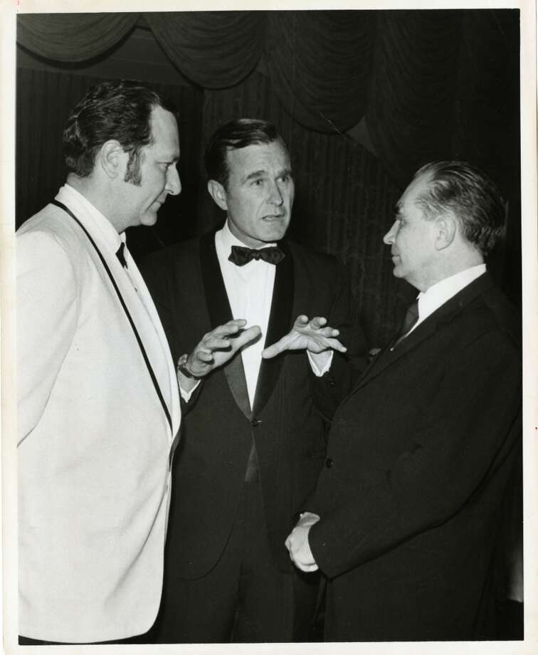 05/20/1970 - (L-R) Professor Nicolai Blokhin of Moscow, U.S. Rep. George Bush and Dr. Emil Freireich of Houston at dinner given by Houston chapter of the Leukemia Society of America. Bela Ugrin / Houston Post   HPOST CAPTION (05/21/1970): Congressman George Bush (center) captured the attention of Professor Nicolai Blokhin of Moscow and Dr. Emil Freireich (left) of Houston at a dinner Wednesday night at the Shamrock Hilton Hotel. It was given by the Houston chapter of the Leukemia Society of America and attracted many of the delegates to the forthcoming International Cancer Congress which starts Friday. Blokhin is the congress president.