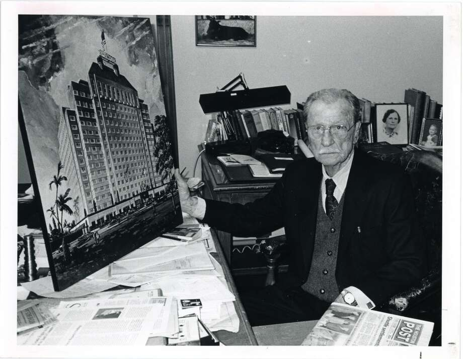 12/30/1986 -- Glenn McCarthy in his office with painting of the Shamrock Hotel. HPOST CAPTION (12/31/1986): Glenn McCarthy.   HPOST CAPTION (12/27/1988): Glenn McCarthy, pictured in 1986 with a photo of the Shamrock Hotel, which he opened in 1949, was among Houstonians who protested its razing in 1987.