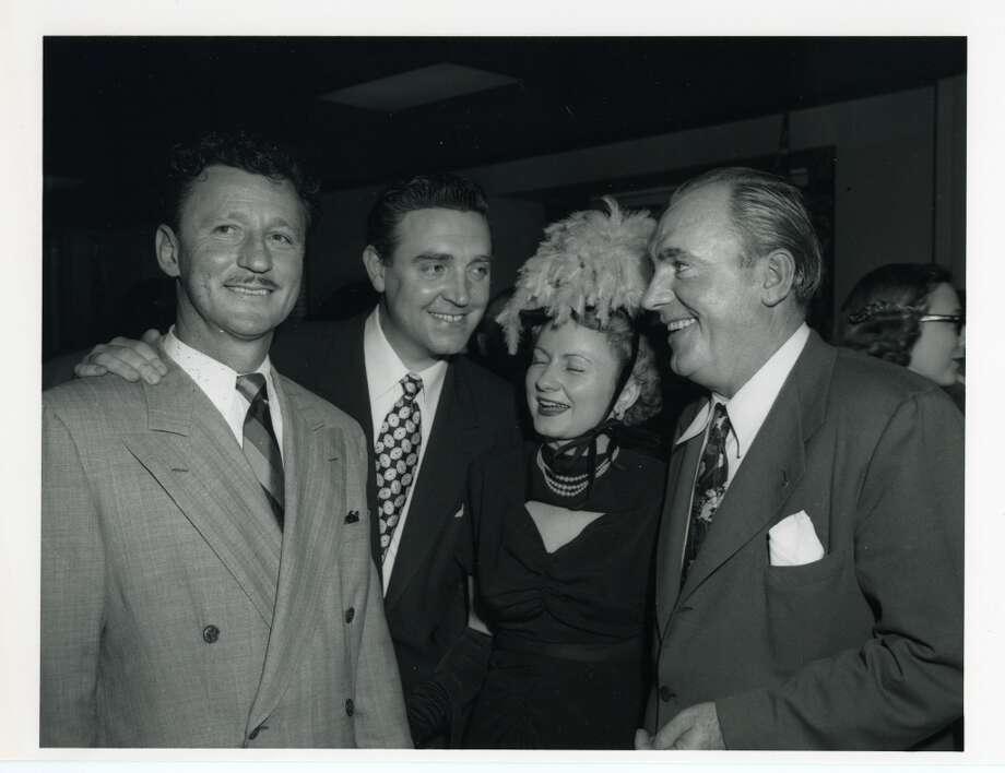 03/17/1949 - (L-R): Houston oilman Glenn McCarthy, actor Robert Paige, Pat Barham and actor Pat O'Brien at Shamrock Hotel grand opening festivities.
