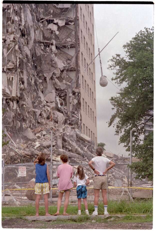 06/08/1987 -- John Horn, his two daughters - Jenny, 14 and Jessica, 8 - and their friend, Rayne Ryan, 14 view the demolition of the Shamrock Hilton Monday afternoon, June 8, 1987.  Buster Dean / Houston Chronicle