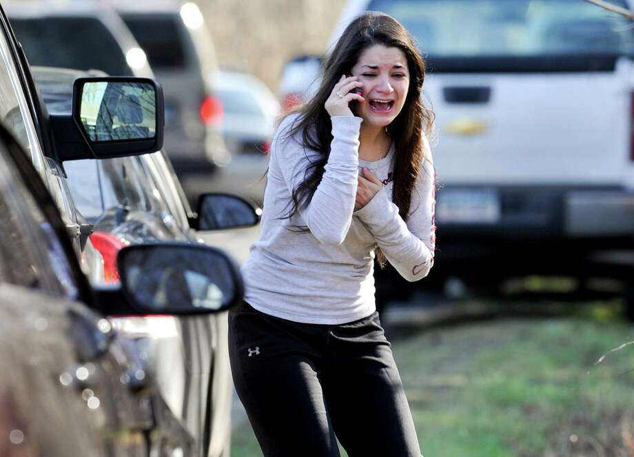 Carlee Soto reacts as she learns her sister, Victoria Soto, a teacher at the Sandy Hook Elementary School, was one of 26 people killed in a shooting at the school in Newtown, Conn. Photo: Jessica Hill