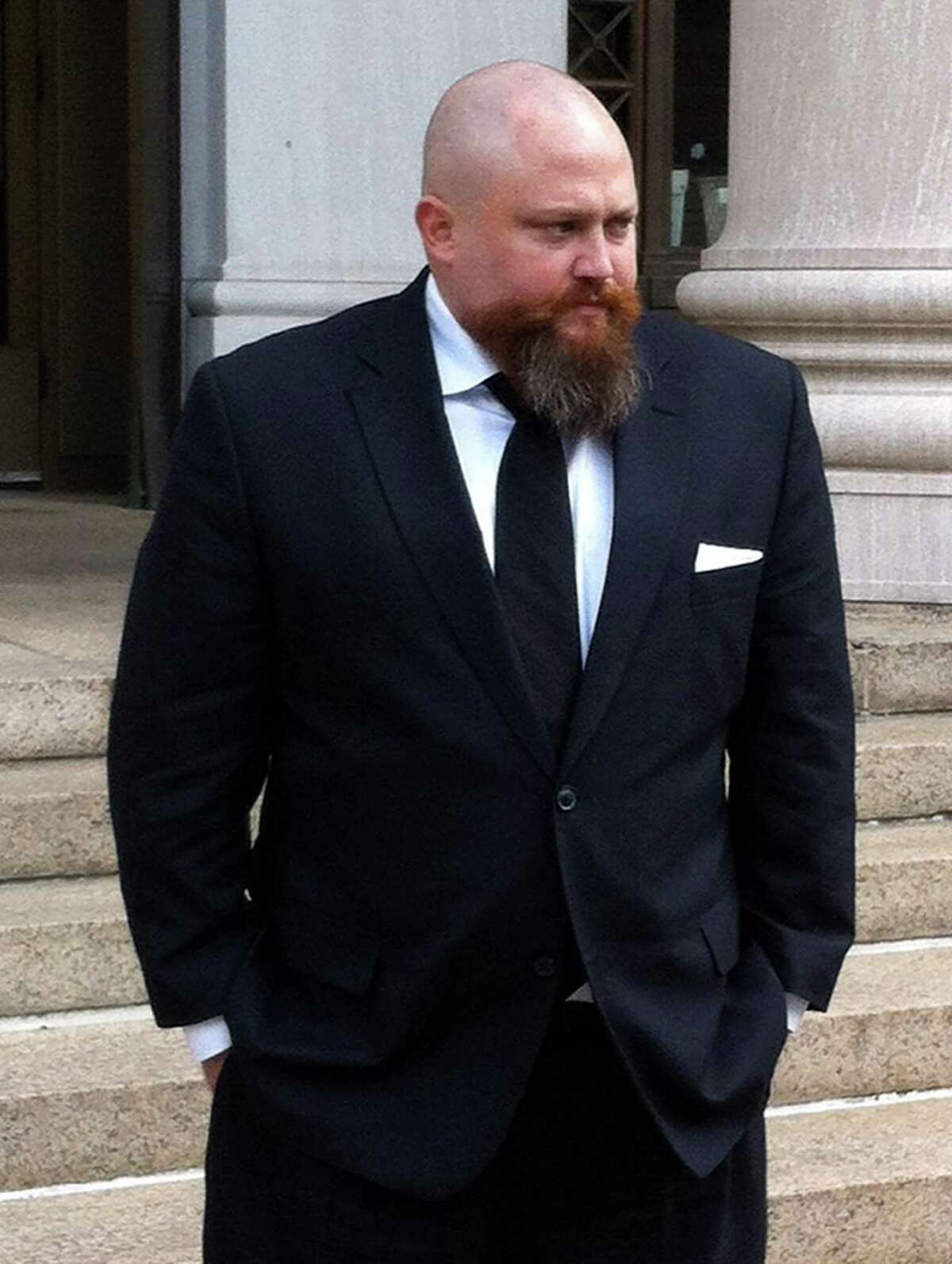 Robert Braddock Jr. walks outside federal court in New Haven, Conn., Monday May 13, 2013. Braddock, the finance director for ex-Connecticut House Speaker's failed congressional campaign last year, is on trial on conspiracy and campaign finance charges.