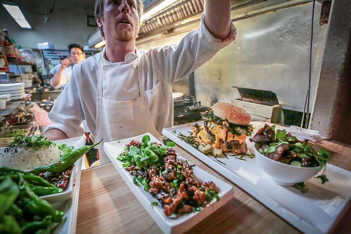 Matt Laurell looks over orders in the kitchen at High Five in Guerneville, Calif., on Thursday, May 9th, 2012.