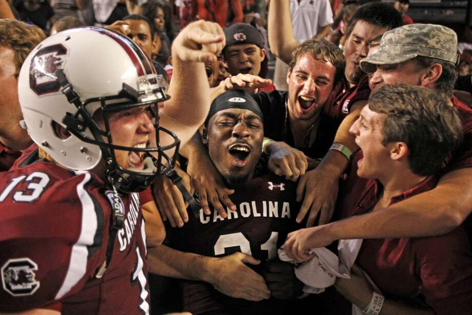 South Carolina running back Marcus Lattimore (21) celebrates with fans after a 35-7 win over Georgia at Williams-Brice Stadium in Columbia, South Carolina, on Saturday, October 6, 2012.