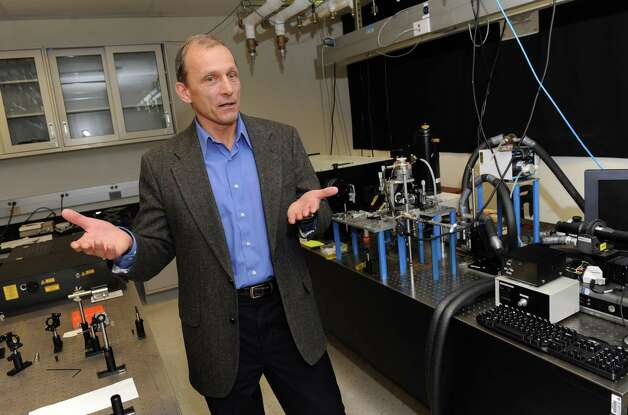 Chemistry professor and forensic scientist Igor Lednev in the laser lab at UAlbany on Thursday Feb. 14, 2013 in Albany, N.Y. Lednev discovered a method for telling the make and caliber of a gun by analyzing gunshot residue. He also serves on the White House subcommittee on forensic science. (Lori Van Buren / Times Union) Photo: Lori Van Buren / 00021163A