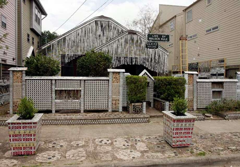 Possibly one of Houston's most well-known work of arts, the Beer Can House was created by the late John Milkovisch, who didn't like throwing anything away not even his beer cans. Photo: James Nielsen, Houston Chronicle / Houston Chronicle