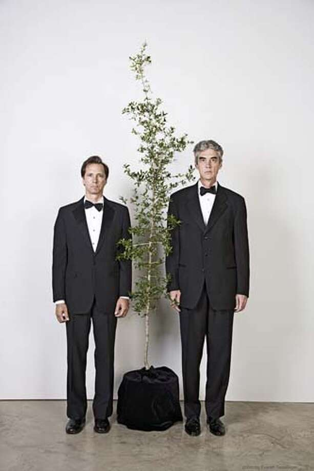 """The Art Guys - Jack Massing, left, and Michael Galbreth - are known for staging odd events. From """"marrying"""" a tree, to auctioning off their own cremated remains, these two are always finding something strange to do. Photo: Everett Taasevigen / handout"""