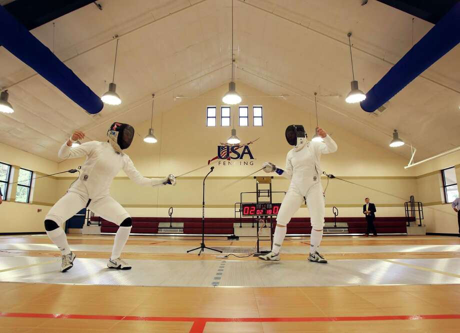 Olympic fencing bronze medal winners Kelley and Courtney Hurley, provide a fencing demonstration during the grand opening celebration for the University of the Incarnate Word's Brain Power Center for Fencing and International Sports on Monday May 13, 2013.  The 18,000 square-foot facility includes eight fencing strips, practice strips and a gymnasium that can be used for basketball and volleyball.  There is also an international sports area for badminton and table tennis along with an armory.   UIW is hoping to develop an NCAA fencing program and provide facilities for a U.S Fencing Association club.  The facility will also serve as a training facility for fencing athletes and host competitions. Photo: Helen L. Montoya, San Antonio Express-News / ©2013 San Antonio Express-News