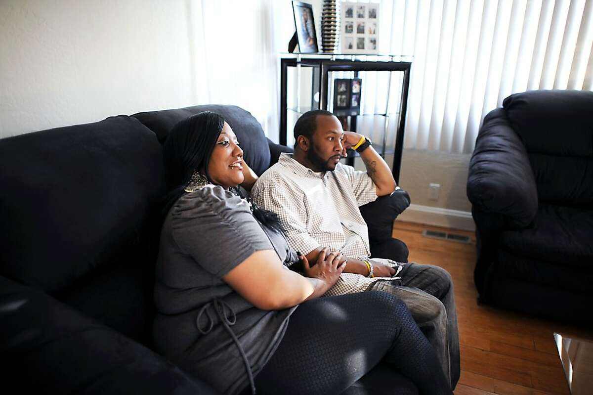 Wakeelah and Andre Davis get ready to watch basketball playoffs at their home in Richmond, CA Tuesday May 7th, 2013. The Davis family recently bought their home with the help of the nonprofit Self Help, which buys and fixes up foreclosures for sale to low-income owners.