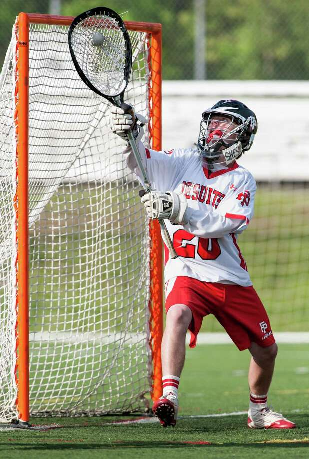 Fairfield Prep goalie Logan Cotter makes a save during a boys lacrosse game against Xavier high school played at Alumni field, Fairfield University, Fairfield, CT on Monday May 13th, 2013. Photo: Mark Conrad / Connecticut Post Freelance