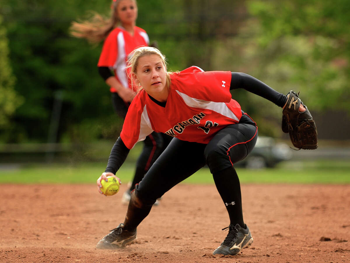 New Canaan second baseman Courtney Rogers barehands an infield ground ball as she looks to throw to first during the third inning of their matchup with Ludlowe in Fairfield, Conn. on Monday, May 13, 2013.