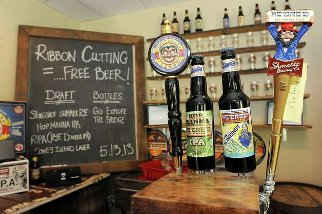 Free beer was on tap during a ribbon cutting ceremony for Shmaltz Brewing Company's new 50- barrel brewery on Monday, May 13, 2013 in Clifton Park, N.Y. (Lori Van Buren / Times Union) Photo: Lori Van Buren / 00022392A