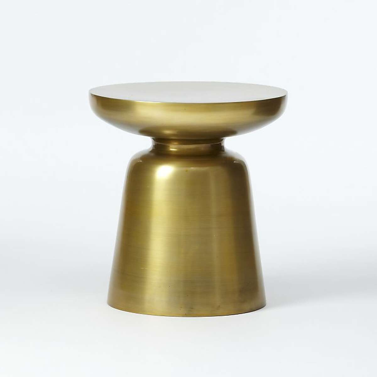 Less: $149 Martini Side Table in antique brass (www.westelm.com) Right off the bat, it s hard to go wrong with this nicely priced side table that West Elm has listed as one of its best-sellers. Sleek yet sculptural, it also has that compact-meets-impact quality that so many of us crave. This one measures 16 inches high and 15 inches in diameter. It s also available in silver, lemon and persimmon.