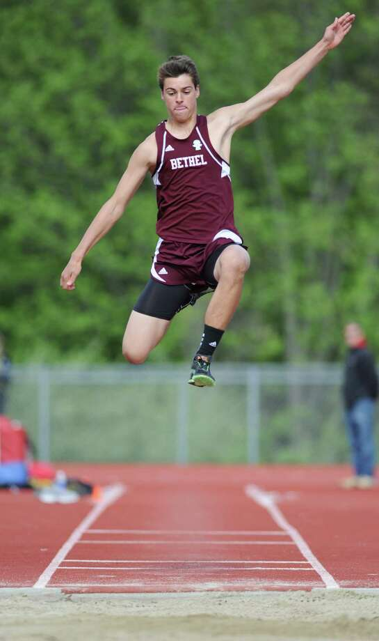 Bethel's Hayden Duffy competes in the long jump at the track and field meet between Pomperaug, New Fairfield, Bethel and Weston at Pomperaug High School in Southbury, Conn. on Monday, May 13, 2013.  New Fairfield won the meet, completing its second consecutive undefeated regular season. Photo: Tyler Sizemore / The News-Times