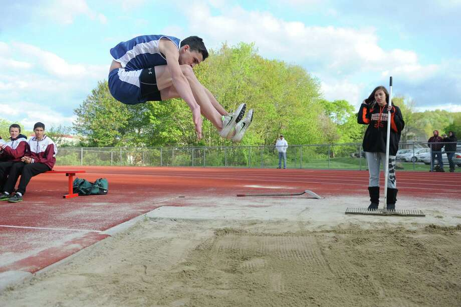 New Fairfield's Dan Rodier competes in the triple-jump at the track and field meet between Pomperaug, New Fairfield, Bethel and Weston at Pomperaug High School in Southbury, Conn. on Monday, May 13, 2013.  New Fairfield won the meet, completing its second consecutive undefeated regular season. Photo: Tyler Sizemore / The News-Times