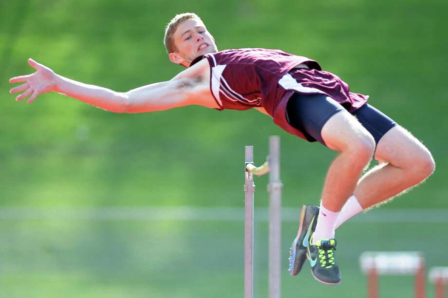 Bethel's Griffin Teed clears the bar of the high jump at the track and field meet between Pomperaug, New Fairfield, Bethel and Weston at Pomperaug High School in Southbury, Conn. on Monday, May 13, 2013.  New Fairfield won the meet, completing its second consecutive undefeated regular season. Photo: Tyler Sizemore / The News-Times