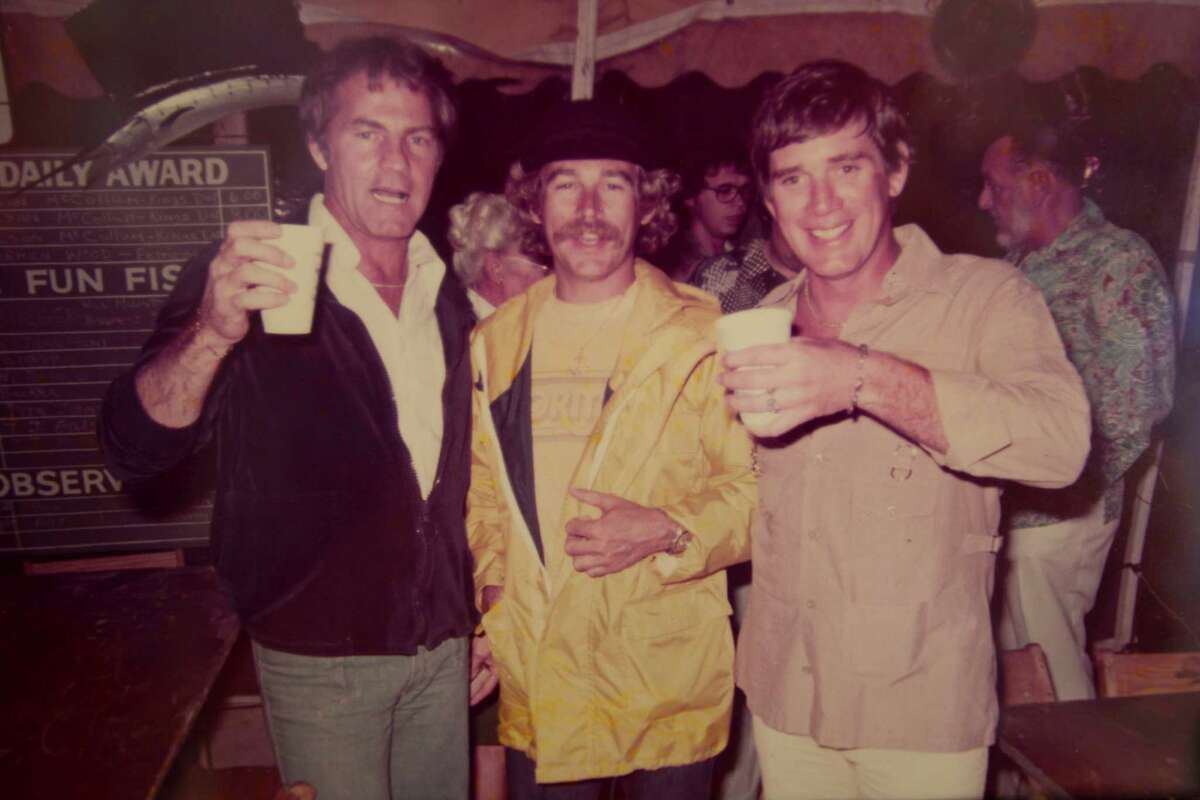Jack Duvall raises a glass with Frank Gifford, left, and Jimmy Buffett at a Key West billfishing tourney.
