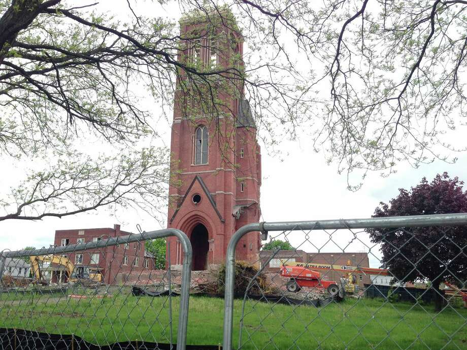 A view of St. Patrick's Church with a portion of the church still standing after demolition attempts last week, is seen here on Monday, May 13, 2013 in Watervliet, NY.  (Paul Buckowski / Times Union) Photo: Paul Buckowski