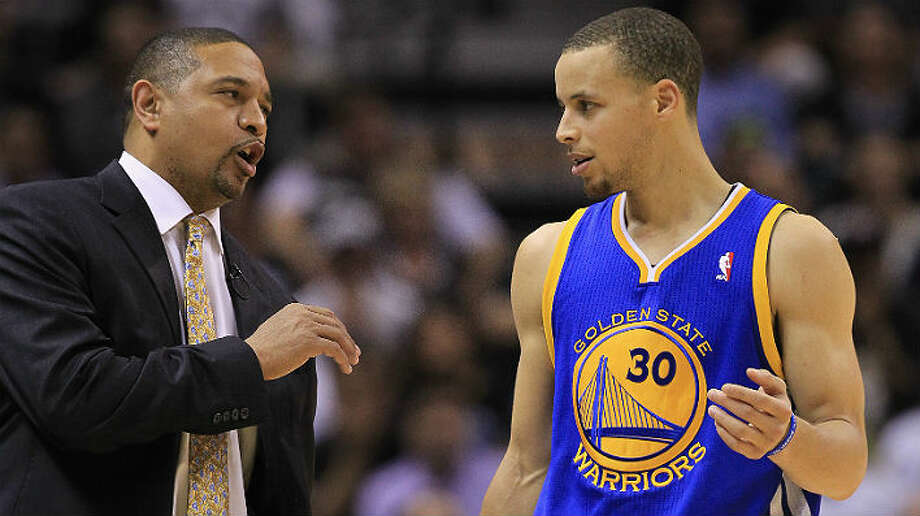 Warriors coach Mark Jackson, a former NBA guard, talks with Warriors guard Stephen Curry during Game 2 against the Spurs on Wednesday at the AT&T Center. Ronald Martinez / Getty Images
