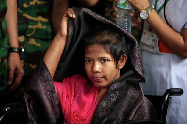 Reshma Begum, the 19-year-old seamstress who spent 17 days trapped in the rubble of a collapsed factory building, adjusts her shawl as she meets the media at a hospital in Savar, near Dhaka, Bangladesh, Monday, May 13, 2013. Begum said Monday that she will never again work in a Bangladesh garment factory.  Nearly three weeks after the Bangladesh garment-factory building collapsed, the search for the dead ended Monday at the site of the worst disaster in the history of the global garment industry. The death toll: 1,127. Photo: A.M. Ahad, Associated Press / AP