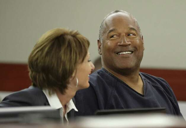 O.J. Simpson (R) talks with his attorney, Patricia Palm during his retrial in Clark County District Court May 13, 2013 in Las Vegas, Nevada. Simpson, who is currently serving a nine to 33-year sentence in state prison as a result of his October 2008 conviction for armed robbery and kidnapping charges, is using a writ of habeas corpus, to seek a new trial, claiming he had such bad representation that his conviction should be reversed. Photo: Pool, Getty Images / 2013 Getty Images