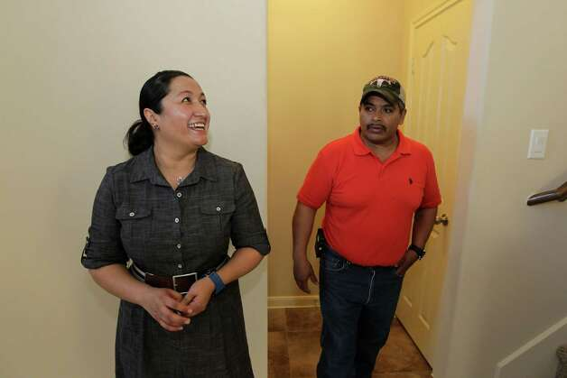 Marta Jimenez, left, and her husband Irineo look over their new home after Houston Mayor Annise Parker visited the Leland Woods subdivision. Leland Woods has taken more than 8 years to complete due to economic and lending issues for the builders during the recession. It became a reality due to the City's guidance and assistance. For the 14 families who are close to closing on their new homes, it is the achievement of the American Dream Monday, May 13, 2013, in Houston. Photo: James Nielsen, Houston Chronicle / © 2013  Houston Chronicle