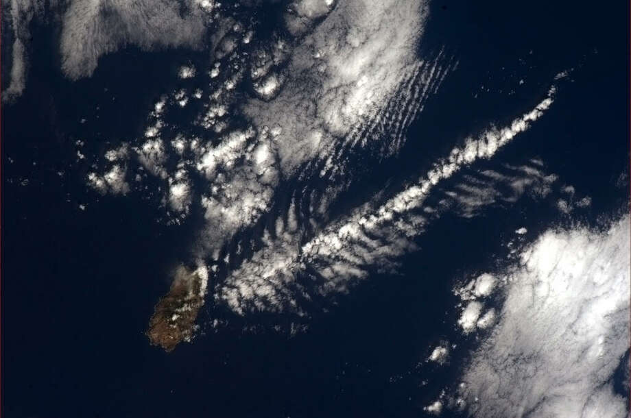 A fishbone cloud, artistically made by St Helena Island, the Atlantic waters, and the wind. (Chris Hadfield/NASA)