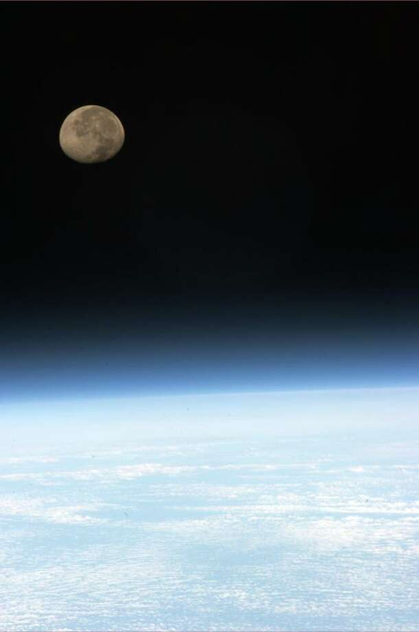 Moonset, which occurs 16 times per day on the ISS. (Chris Hadfield/NASA)