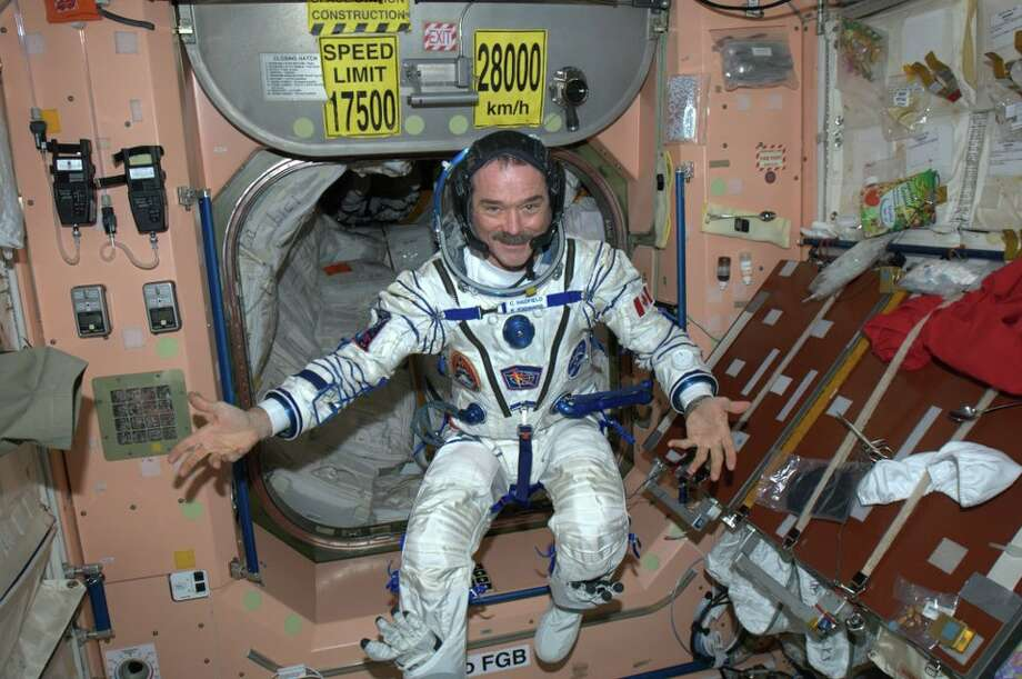 Trying on the Soyuz suit for the return to Earth. (NASA)