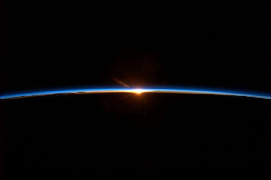 "Posted today. Hadfield wrote, ""Spaceflight finale: To some this may look like a sunset. But it's a new dawn."" (Chris Hadfield/NASA)"