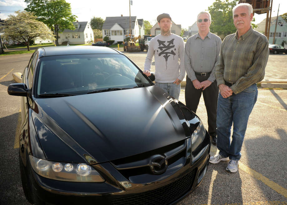 From left; Steve Wampler, of Stratford, Bob Sheehy, of Shelton, and Larry Wells, of Stratford, are putting on a classic car show at the Holy Name of Jesus Church in Stratford to benefit the children of the Tanski family. Photo: Brian A. Pounds / Connecticut Post