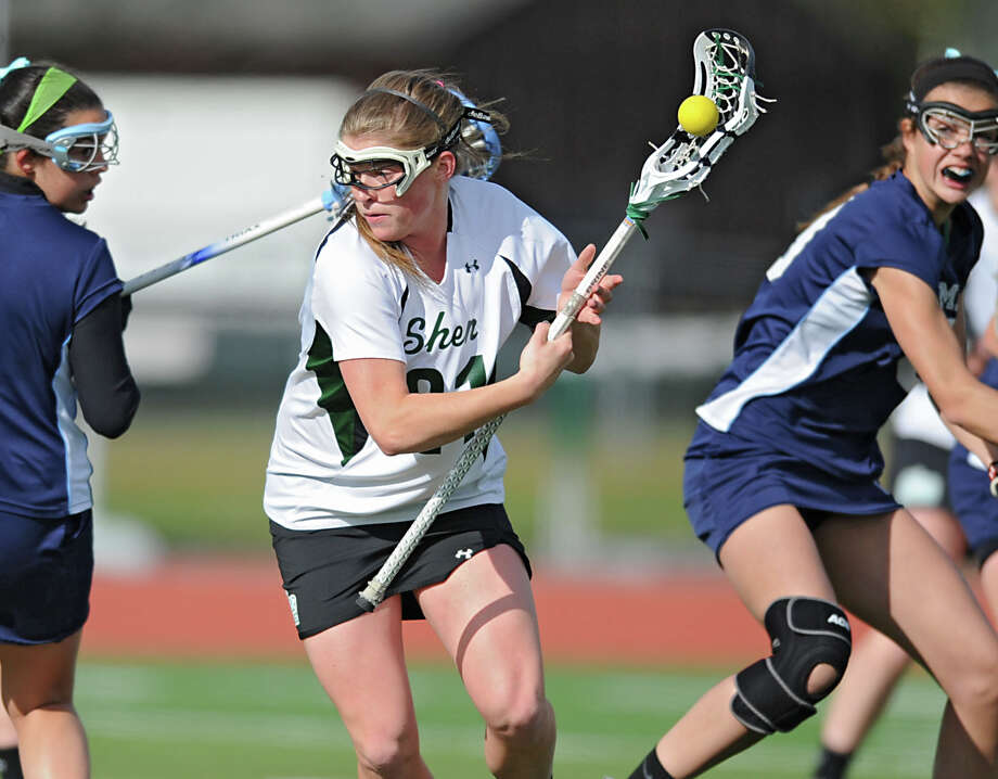 Shenendehowa senior attack Kelly Wall, center, runs with the ball during a lacrosse game against Columbia on Monday, May 13, 2013 in Clifton Park, N.Y. (Lori Van Buren / Times Union) Photo: Lori Van Buren / 00022393A