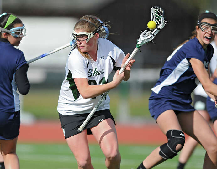 Shenendehowa senior attack Kelly Wall, center, runs with the ball during a lacrosse game against Col