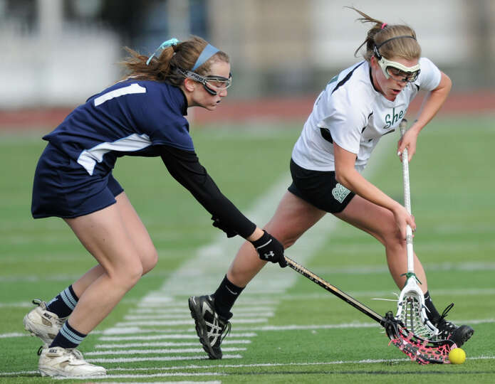 Columbia's MaryKate Chester, left, battles for the ball with Shenendehowa senior attack Kelly Wall d