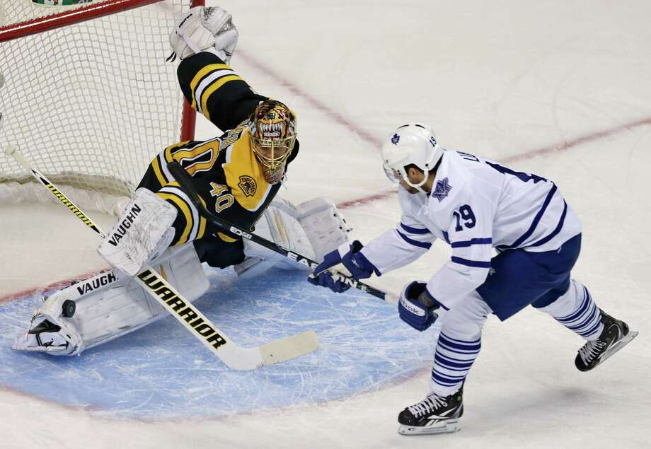 Boston Bruins goalie Tuukka Rask (40) makes a pad save on a shot by Toronto Maple Leafs right wing Joffrey Lupul, right, during the first period in Game 7 of their NHL hockey Stanley Cup playoff series in Boston, Monday, May 13, 2013. Photo: Charles Krupa