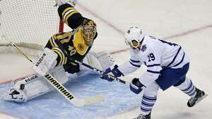 Boston Bruins goalie Tuukka Rask (40) makes a pad save on a shot by Toronto Maple Leafs right wing Joffrey Lupul, right, during the first period in Game 7 of their NHL hockey Stanley Cup playoff series in Boston, Monday, May 13, 2013.