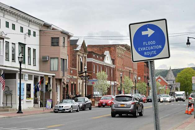 Flood evacuation route sign on Main St. in Schoharie, NY Wednesday May 8, 2013.   (John Carl D'Annibale / Times Union) Photo: John Carl D'Annibale