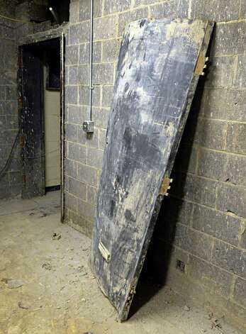 The flood water buckled steel door to the old generator room in the basement of the Schoharie County office building in Schoharie, NY Wednesday May 8, 2013.   (John Carl D'Annibale / Times Union) Photo: John Carl D'Annibale