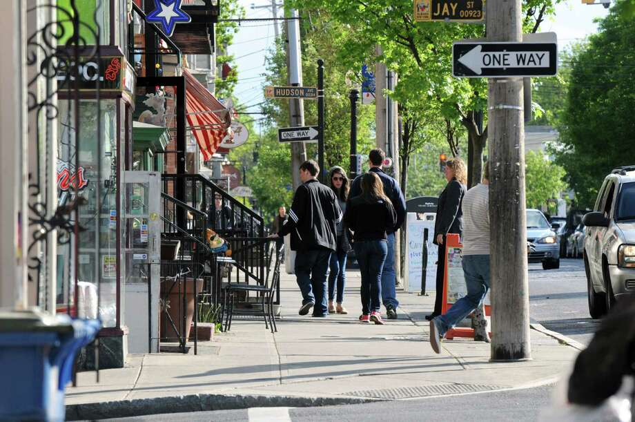 People traverse the Lark Street sidewalks, Monday afternoon May, 13, 2013,  in Albany, N.Y. (Will Waldron/Times Union) Photo: Will Waldron