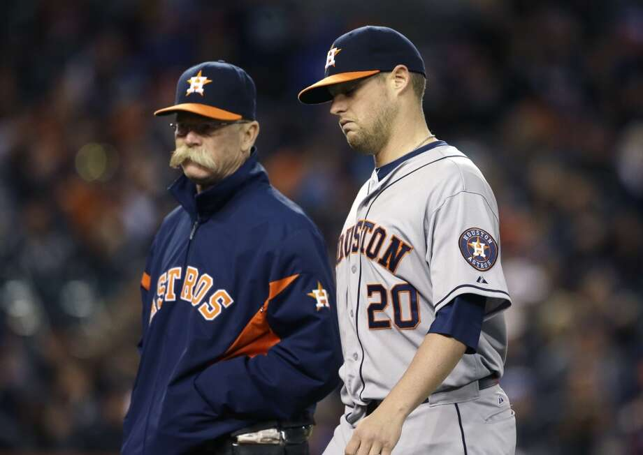 Astros pitcher Bud Norris leaves the game after suffering back spasms.