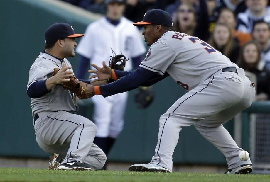 Astros second baseman Jose Altuve, left, and right fielder Jimmy Paredes collide trying to catch a single.