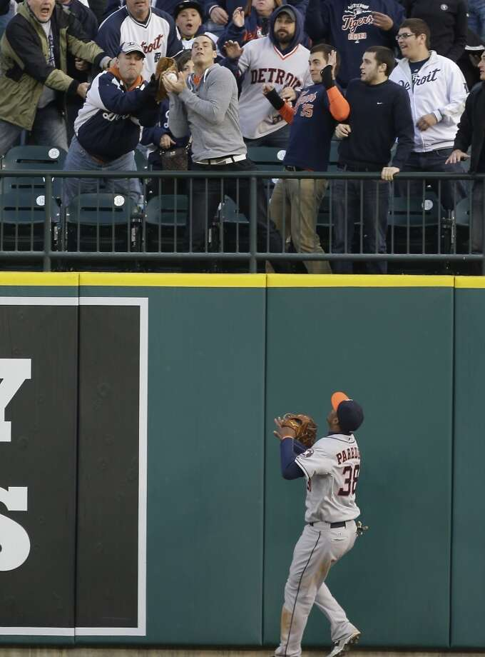Jimmy Paredes of the Astros watches the flight of a home run hit by Victor Martinez of the Tigers during the fourth inning.