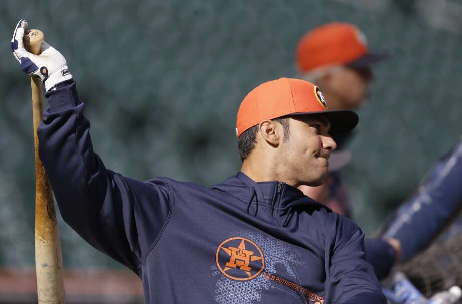 Carlos Pena of the Astros takes batting practice before facing the Tigers
