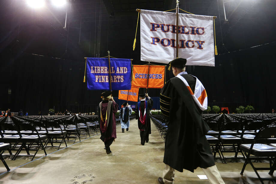 Faculty holding the college banners enter the University of Texas at San Antonio first of two graduation ceremonies at the Alamodome, Monday, May 13, 2013. Photo: JERRY LARA, San Antonio Express-News / © 2013 San Antonio Express-News