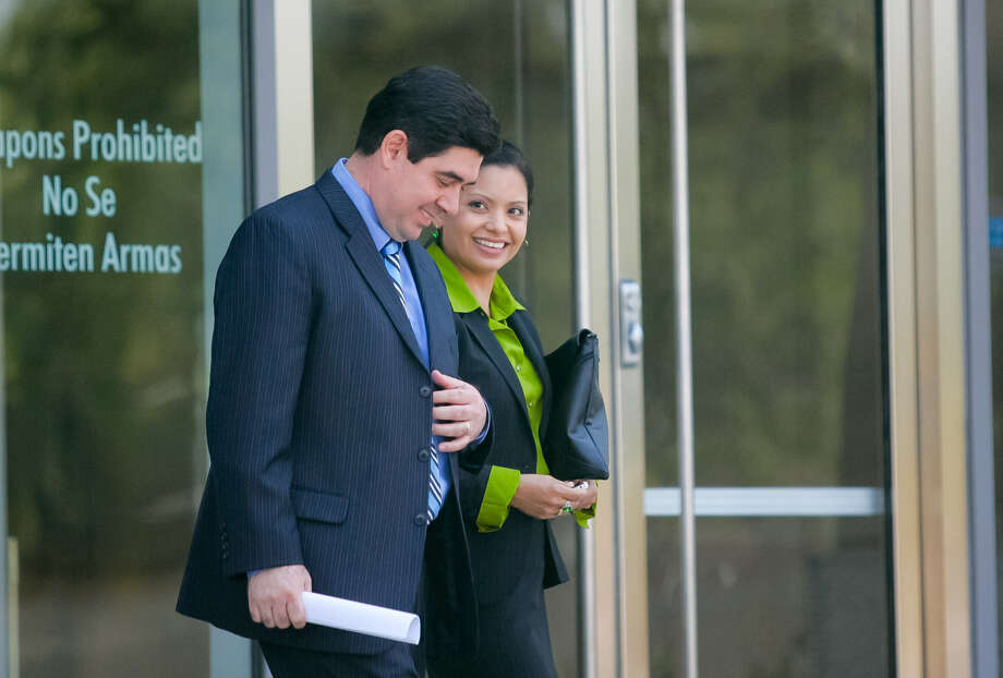 Ex-Cameron County DA Armando Villalobos and his wife Yolanda walk out of the federal courthouse in Brownsville during his trial on extortion and racketeering charges. Photo: Associated Press