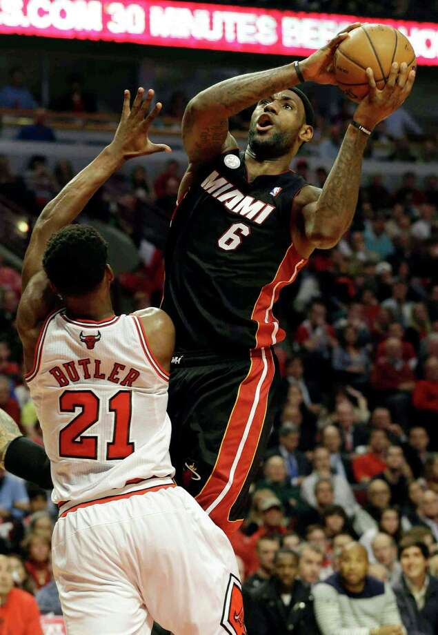 Miami Heat forward LeBron James (6) goes up for a shot against Chicago Bulls forward Jimmy Butler (21) during the first half of Game 4 of an NBA basketball playoffs Eastern Conference semifinal on Monday, May 13, 2013, in Chicago. (AP Photo/Nam Y. Huh) Photo: Nam Y. Huh